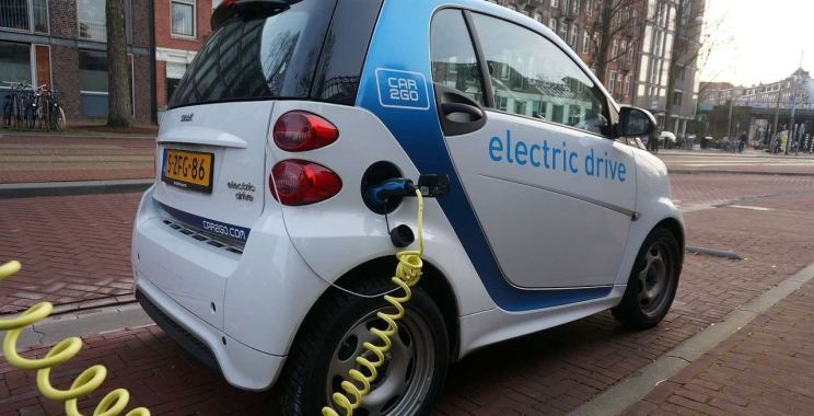 How to start or buy an electric car Automobile company in India?